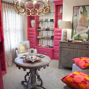 Inspiration for a mid-sized eclectic women's dressing room in Charleston with raised-panel cabinets, red cabinets and carpet.
