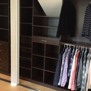 Dark wood his & hers reach-in closets