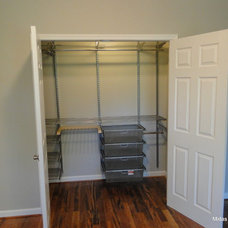 Traditional Closet by Midas Construction