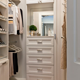 Small transitional women's medium tone wood floor walk-in closet photo in Other with recessed-panel cabinets and beige cabinets