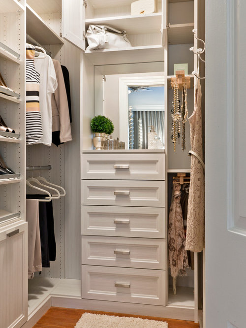 Transitional women's medium tone wood floor walk-in closet photo in DC  Metro with recessed