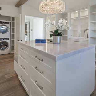 Inspiration for a beach style closet remodel in Orange County