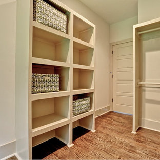 Example Of A Midcentury Modern Closet Design In Atlanta