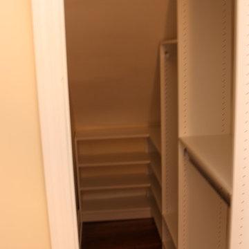 Deep Narrow Angled Ceiling Walk in Closet