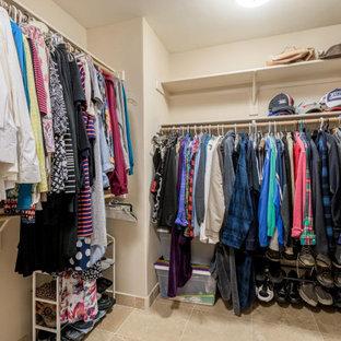Design ideas for a medium sized gender neutral walk-in wardrobe in Phoenix with travertine flooring and beige floors.