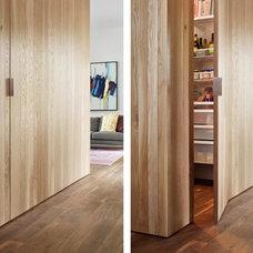 Midcentury Closet by Stuart Sampley Architect