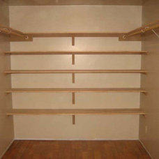 Traditional Closet by Baca Construction