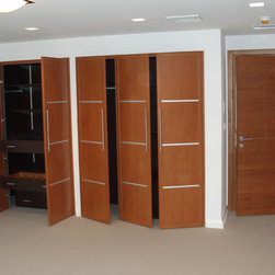 Doors make up the room - Custom made-to-measure closet doors in Cherry coordinated with shelving in Wenge.  Interior door is solid wood cherry with single horizontal insert in satin chrome.