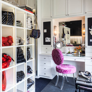 Example of a classic carpeted dressing room design in New York with white cabinets