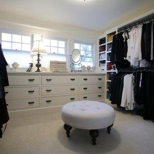 Foto de vestidor de mujer, tradicional, grande, con armarios abiertos, puertas de armario blancas y suelo de baldosas de cerámica