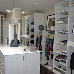 Design ideas for a large asian women's walk-in wardrobe in New York with open cabinets, white cabinets and dark hardwood floors.