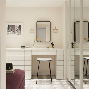 Example of a trendy women's multicolored floor dressing room design in New York with flat-panel cabinets and white cabinets