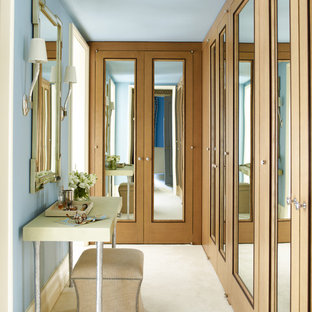 Transitional carpeted and beige floor dressing room photo in New York with recessed-panel cabinets and medium tone wood cabinets