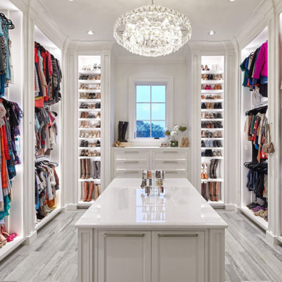 Walk-in closet - traditional gray floor walk-in closet idea in Houston with beaded inset cabinets and white cabinets
