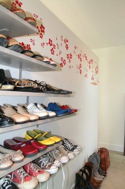 eclectic closet by Cass Cheesar Architects, LLC