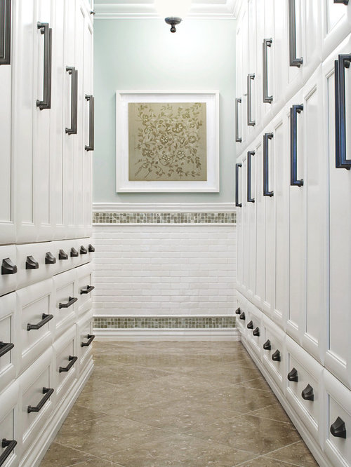 Closet Floor Limestone Inspiration for a large timeless dressing room remodel in Charleston with limestone floors, recessed-