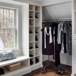 Dressing room - transitional women's medium tone wood floor dressing room idea in Boston with open cabinets and white cabinets