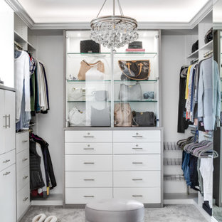 Mid-sized tuscan women's carpeted and gray floor walk-in closet photo in Los Angeles with flat-panel cabinets and white cabinets