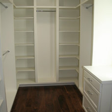 Traditional Closet by Core Development Group, Inc.