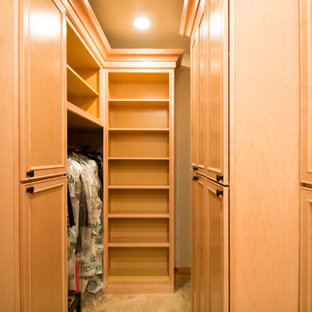 Design ideas for a large classic gender neutral walk-in wardrobe in Denver with raised-panel cabinets, light wood cabinets, travertine flooring and beige floors.