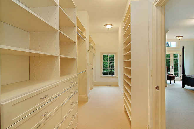 Contemporary Closet by Erotas Building Corporation