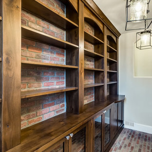 Inspiration for a large timeless gender-neutral brick floor walk-in closet remodel in Denver with shaker cabinets and medium tone wood cabinets