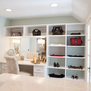 Inspiration for a large country gender-neutral dressing room in Chicago with white cabinets, medium hardwood floors and raised-panel cabinets.