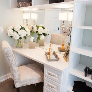 Inspiration for a large cottage gender-neutral medium tone wood floor dressing room remodel in Chicago with white cabinets and raised-panel cabinets
