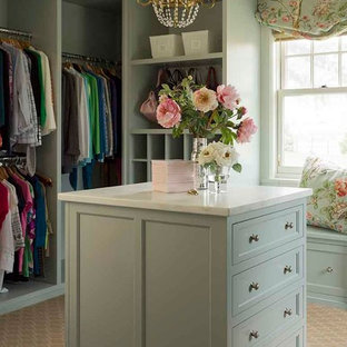 Inspiration for a mid-sized traditional women's dressing room in Los Angeles with shaker cabinets, carpet, green cabinets and beige floor.