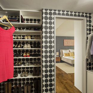 Inspiration for a contemporary women's medium tone wood floor walk-in closet remodel in Boston with open cabinets and white cabinets