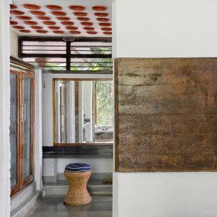 Ispirazione per una grande cabina armadio unisex country con ante di vetro, ante in legno scuro, pavimento in marmo e pavimento multicolore