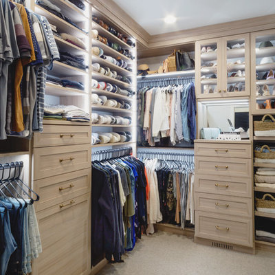 Example of a mid-sized transitional gender-neutral carpeted and beige floor walk-in closet design in Minneapolis with shaker cabinets and medium tone wood cabinets