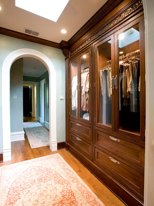 Inspiration For A Timeless Reach In Closet Remodel In Chicago With  Glass Front Cabinets