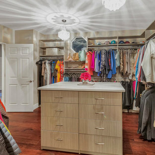 Design ideas for a large midcentury gender-neutral walk-in wardrobe in Los Angeles with open cabinets, light wood cabinets, medium hardwood floors and brown floor.