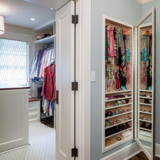 Inspiration for a large timeless women's dark wood floor dressing room remodel in Minneapolis with open cabinets and white cabinets