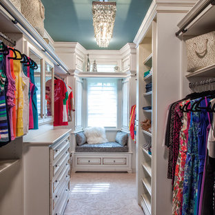 This is an example of a traditional women's dressing room in Detroit with open cabinets, white cabinets and carpet.