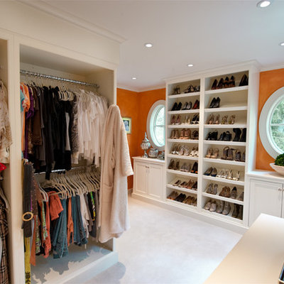 Elegant women's carpeted dressing room photo in Philadelphia with open cabinets and white cabinets