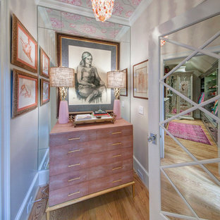 Inspiration for a mid-sized eclectic women's medium tone wood floor closet remodel in Other with gray cabinets
