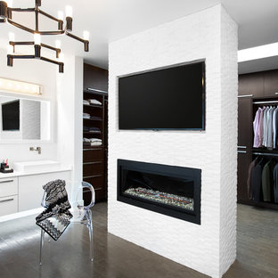 Large contemporary men's dressing room in Vancouver with flat-panel cabinets and dark wood cabinets.