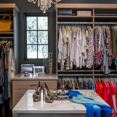 Inspiration for a large transitional women's carpeted dressing room remodel in Austin with open cabinets and light wood cabinets