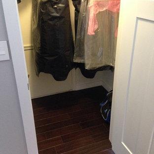 Example of a dark wood floor closet design in New York