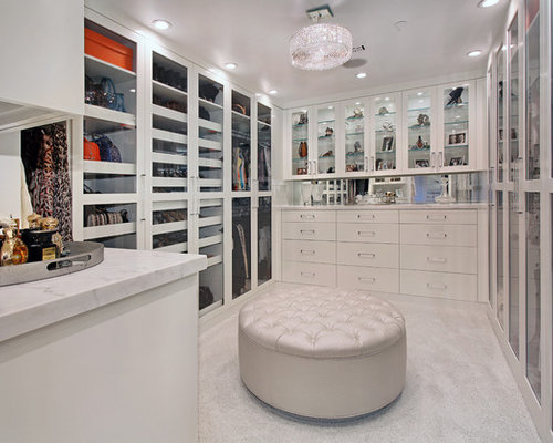 Contemporary Womenu0027s Carpeted Walk In Closet Idea In Orange County With  Glass Front Cabinets