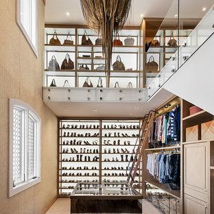 Example of a mountain style women's carpeted walk-in closet design in Phoenix with open cabinets