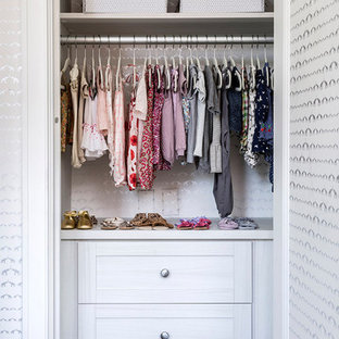Closet - transitional closet idea in New York with open cabinets and white cabinets