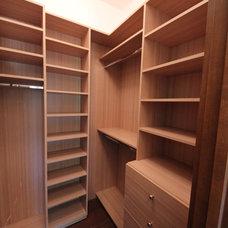 Contemporary Closet by House of Closets, Inc.