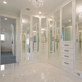 Design ideas for a large classic gender neutral walk-in wardrobe in Vancouver with white cabinets and marble flooring.