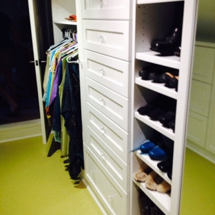 Walk-in closet - small eclectic gender-neutral green floor walk-in closet idea in Other with open cabinets and white cabinets