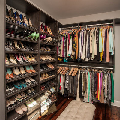 Example of a trendy dressing room design in Atlanta with open cabinets and dark wood cabinets