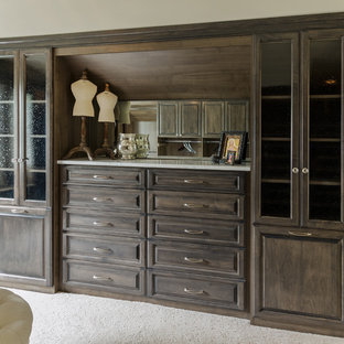 Large transitional gender-neutral carpeted dressing room photo in Richmond with medium tone wood cabinets