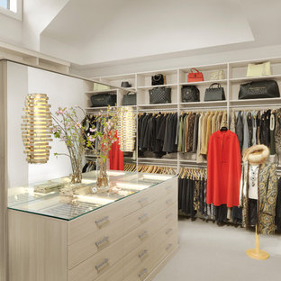 Example of a transitional gender-neutral carpeted and white floor dressing room design in St Louis with open cabinets and beige cabinets